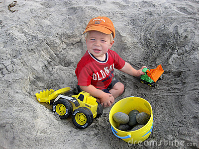 boy-playing-with-trucks-at-the-beach